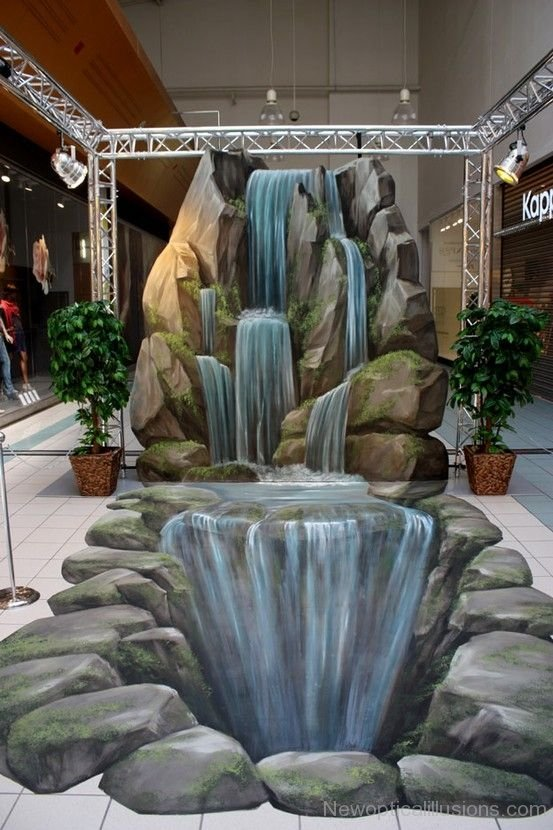 Waterfalls indoors...one real, one not. Image Courtesy:  NewOpticalIllusions.com
