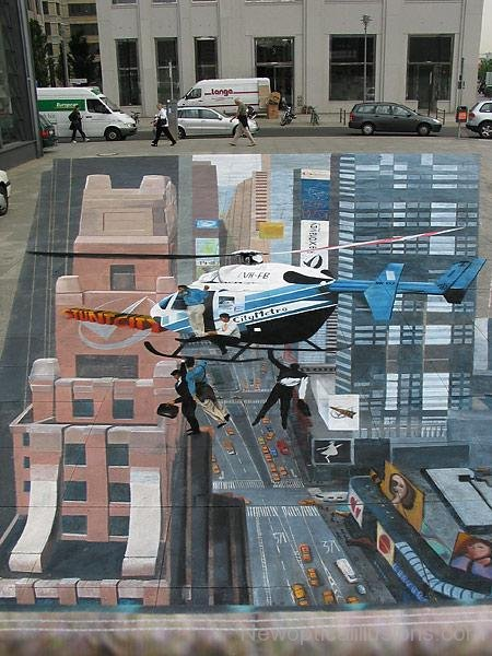 Wild stunt in the city! Image Courtesy:  NewOpticalIllusions.com