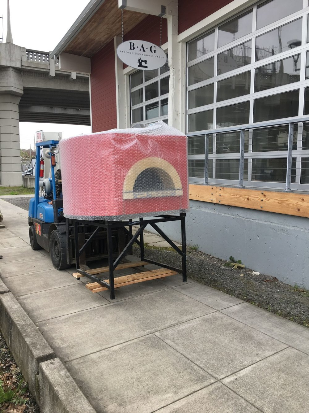 Bringing in the wood-fired oven to PDX's Tilikum Station....Mmmmmm ;) Image Courtesy: NewSchoolBeer.com