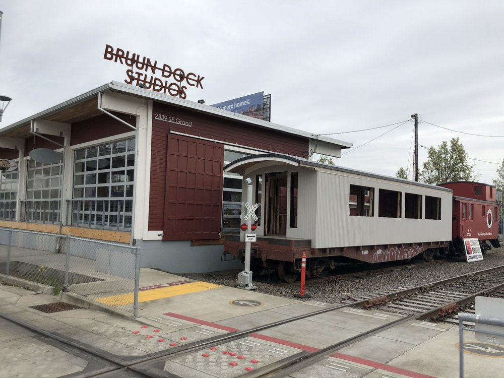 Looking at the new Tilikum Station restaurant, still under construction here in May of 2018. Sitting directly across the street from the NW Rail Museum, here's a chance to see a great museum and get your fill of top-end pizza and craft beer via Mt. Hood Brewing! Image Courtesy: NewSchoolBeer.com