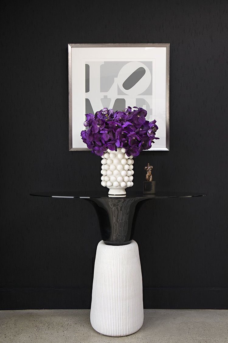 Right off the bat we get a taste of maximal minimalism the black and white color palette evokes a sense of minimalism but the vivid pop of purple adds a