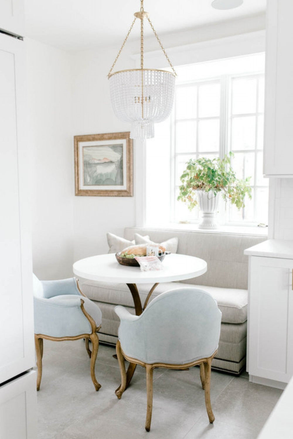 This Dining Nook Is The Definition Of Adorable I Love Pastel Blue Upholstered Chairs Along With Bench And Bistro Table Im A Big Fan Beaded