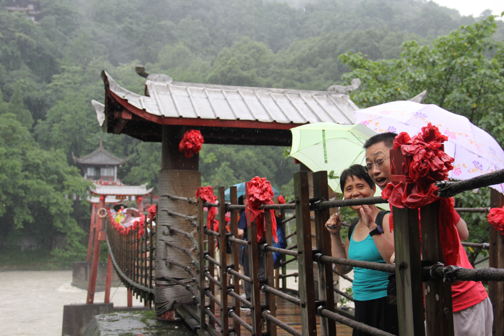 """My parents on """"the Husband and Wife Bridge"""" at Dujiangyan"""