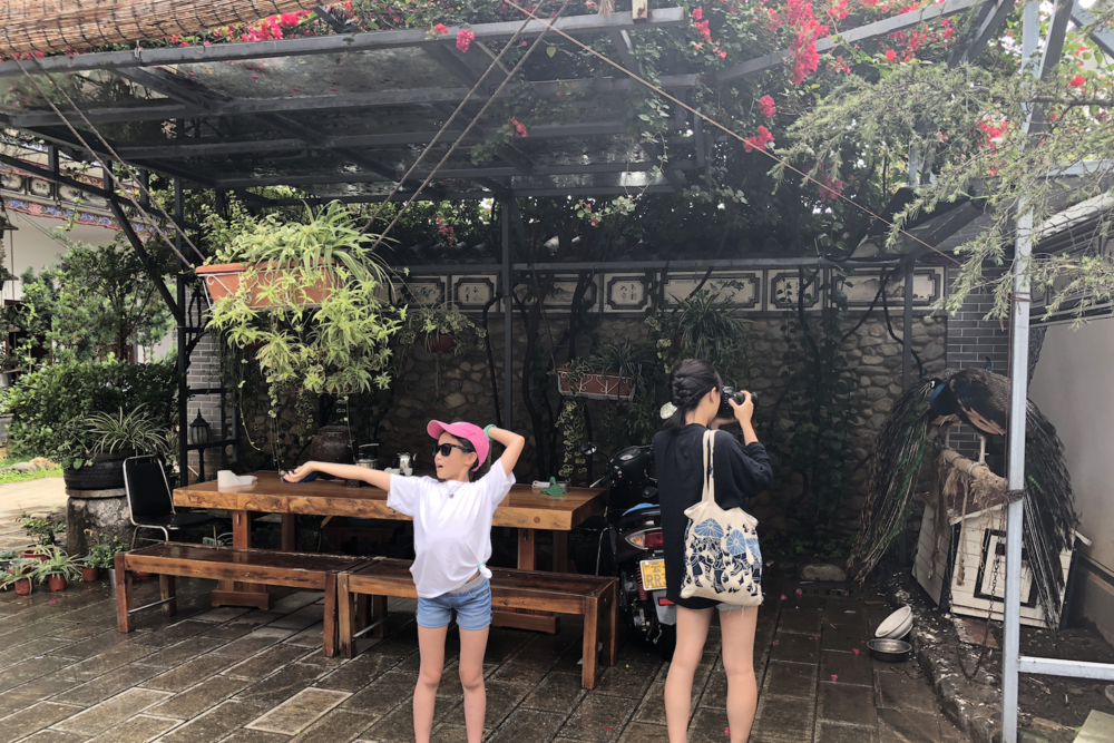 Our wonderful hotel located in the heart of old-town Dali - a gorgeous rustic space filled with plants. Me taking a picture of their two peacock pets - the metal shackles were really depressing. Apparently they used to roam around but one day tried to run away :(