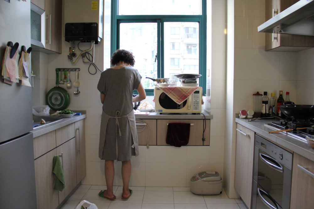 My Eryi (aunt) working hard in the kitchen