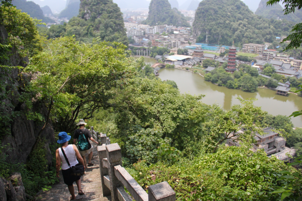 The gorgeous landscape of Guilin - lakes connected by rivers with Karst limestone hills throughout.