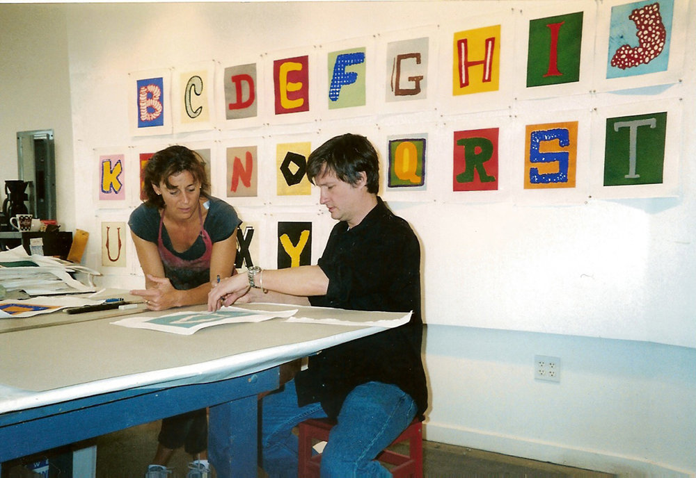 Renée Bott works with Donald Baechler on  Alphabet,  2003 Paulson Bott Press studio Berkeley CA.