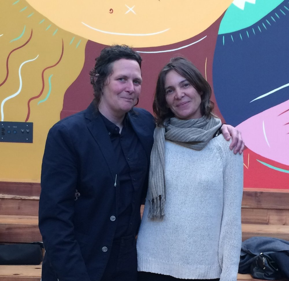 Alicia McCarthy wraps her arm around Ruby Neri at the Berkeley Art Museum, 2018