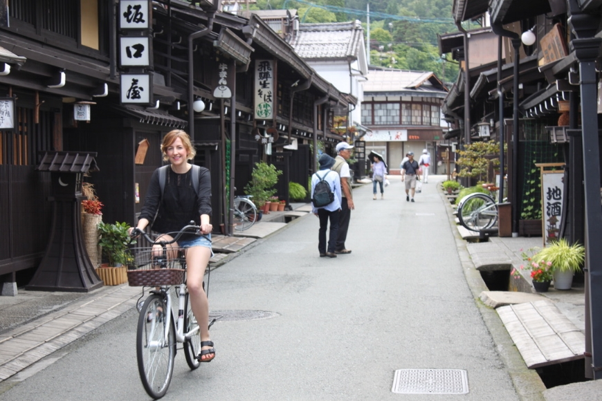 Cycling through Sanmachi Suji, the historic merchant district of Takayama. (Photo: Chloe Berge)