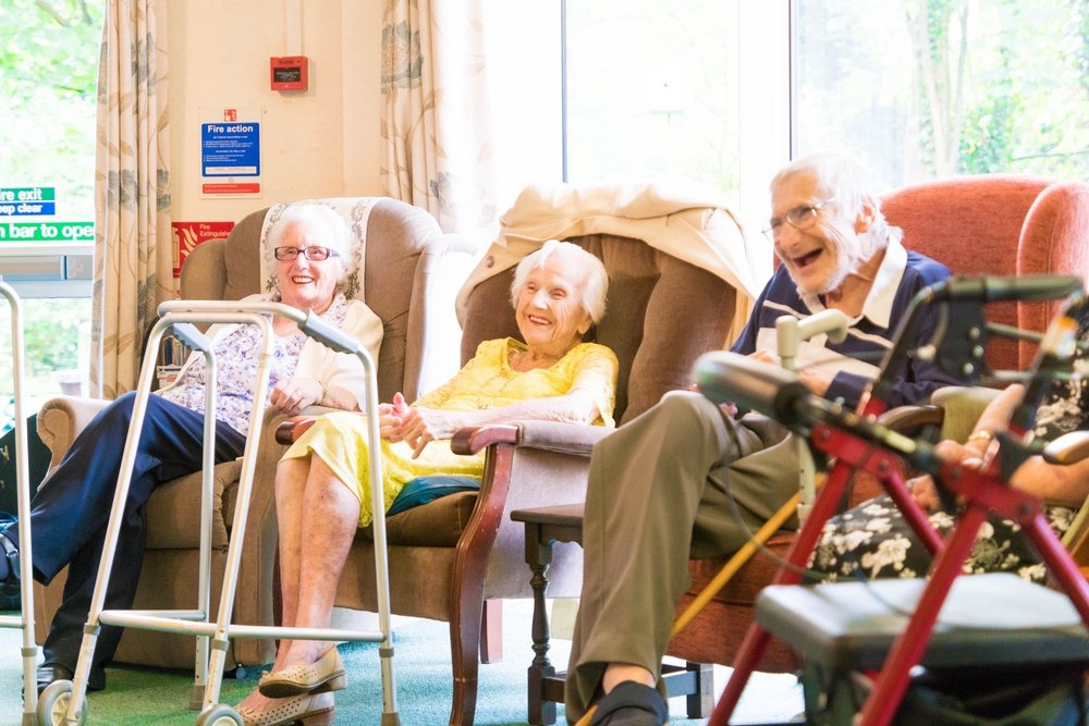 The shared sitting room provides a space for the residents to socialise and take part in activities together