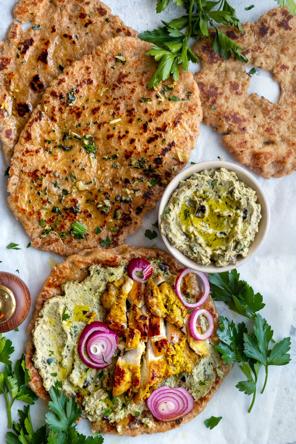 Flat bread served with eggplant dip and roast chicken -
