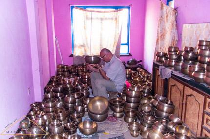 Selecting singing bowls in Kathmandu, Nepal