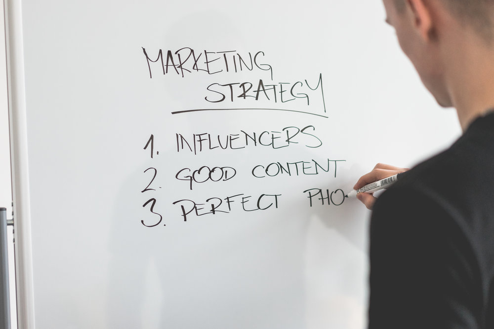 marketing-expert-writing-new-marketing-strategy-on-whiteboard-picjumbo-com.jpg