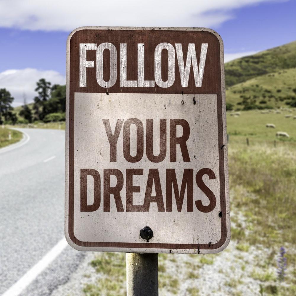 bigstock-Follow-your-dreams-road-sign-o-75557200-e1428766138428 2.jpg