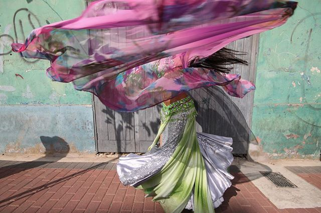 "It's Friday, let's dance! 💃🏽 We are so delighted to feature again the work of travel and street photographer ©️Geraint Rowland (@geraint_rowland_photography). ""The Dancer, Lima, 2013"" was made of a belly dancer on the streets of Miraflores in Lima, Peru. Geraint is available and interested in photographic opportunities around the world.  About the artist: ""Geraint is a travel and street photographer from Cardiff, Wales. He has spent a large part of the last seven years living and working in South America, with the majority of time spent in Lima, Peru. He likes to capture the beauty that exists around the world as well as documenting people in a candid manner. He has had his photographs published in various national newspapers in the UK as well as several magazines. Geraint has exhibited in Lima, Peru, and Cardiff & London, UK. A large number of his images are available for licensing via Getty images."" - #fromstreetswithlove #life_is_street  #everybodystreet #storyofthestreet #ourstreets #everydayeverywhere #StreetPhotographersCommunity #streetphotographyworldwide #street_photography #streetphotography  #streets_storytelling #LensOnStreets #bestofstreet #capturestreets #burnmyeye #lensculture  #lensculturestreets  #dreaminstreets  #streetphotographyhub #travelphotography #streetshooter #capturestreets #fineart #peru #travelphotographer #streets_storytelling #apfmagazine #dancer #friendsinperson #spicollective"