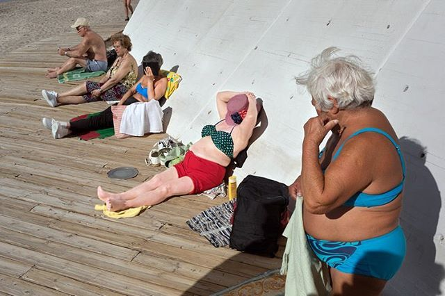 "This cold, rainy NYC weather has us wishing we could jump into this photograph right about now...! 🏖 👙 ""Sunbathing"" by ©️Peter Kool (@kool_peter). Photograph made in Benidorm, Spain. About the artist: ""I saw the light of life in 1953 in The Netherlands; must have been one of those flash bulbs they used back then. Moved to Belgium in 1973 and worked in a steel factory for 35 years; taking pictures on the side. A few years ago I moved aside the factory and started a second life; almost completely dedicated to photography. I like to wander around with a purpose, the hunt for a photo enhances the electricity in the streets. My mpp (miles per photo) is rather high though, but liking to hold my camera makes it endurable; that's why some mechanophilia might be involved too. Anyway, the doing and the outcome makes street photography a double delight."" Thank you for your participation in the project, @kool_peter! 🙏🏽 - - - #fromstreetswithlove #life_is_street  #everybodystreet #storyofthestreet #ourstreets #everydayeverywhere #StreetPhotographersCommunity #streetphotographyworldwide #street_photography #streetphotography  #streets_storytelling #LensOnStreets #bestofstreet #capturestreets #burnmyeye #lensculture  #lensculturestreets  #dreaminstreets  #apfmagazine #streetshooter #capturestreets #spicollective #burnmagazine #sunbathing #sunbathers #spainstreets #everyday_spain"