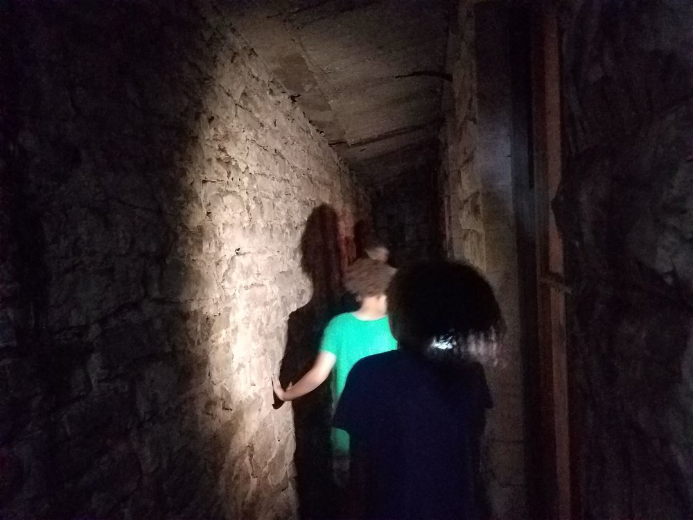 Explore the Underground on the  Original Walking Tour of Downtown Eureka Springs .
