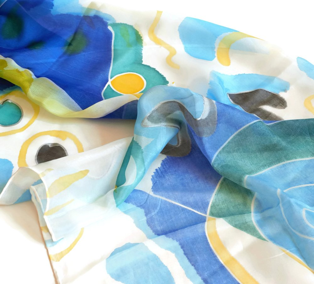 Hand Painted Silk Scarves - Our collection of hand painted, pure silk scarves are a luxurious mix of vibrant and eye catching designs.  Following our collection of jewellery, our silk scarves are similarly inspired by our love of colour and abstract design, effortlessly combined with the soft beauty of silk to create elegant and versatile pieces of wearable art.