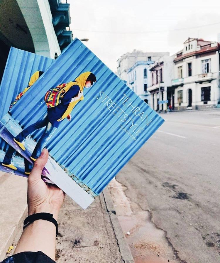 Hoda Katebi holding her books,  Tehran Streetstyle , on her trip to Havana, Cuba.