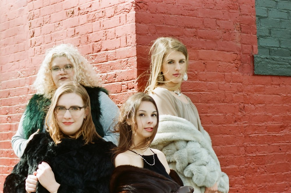A variety of fur, faux to vintage, worn by the team members of Sustain The Mag.
