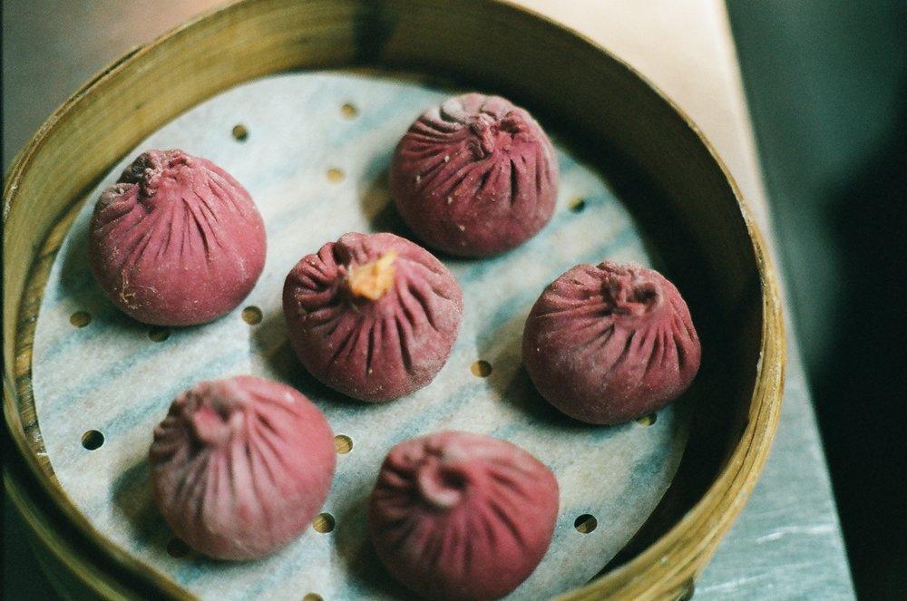 Frozen handmade beet xiao long baos.