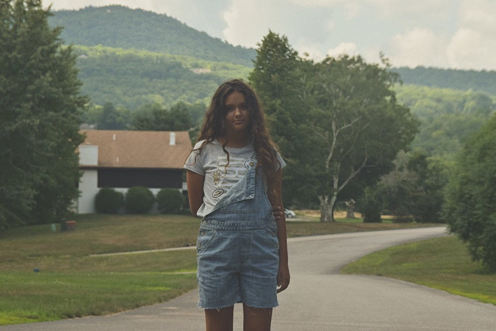 My cousin Adriana in front of our condo in Glen, New Hampshire.