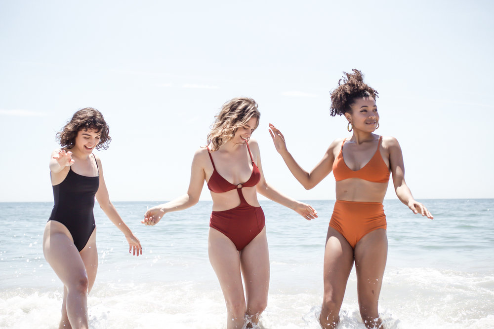 From left to right:  The Saltwater Collective Paulina One-Piece ,  Galamaar Oh Margot! One-Piece ,  HARA Pumpkin Stella Low Cut Bra  +  HARA Pumpkin Lena High Waist Undies