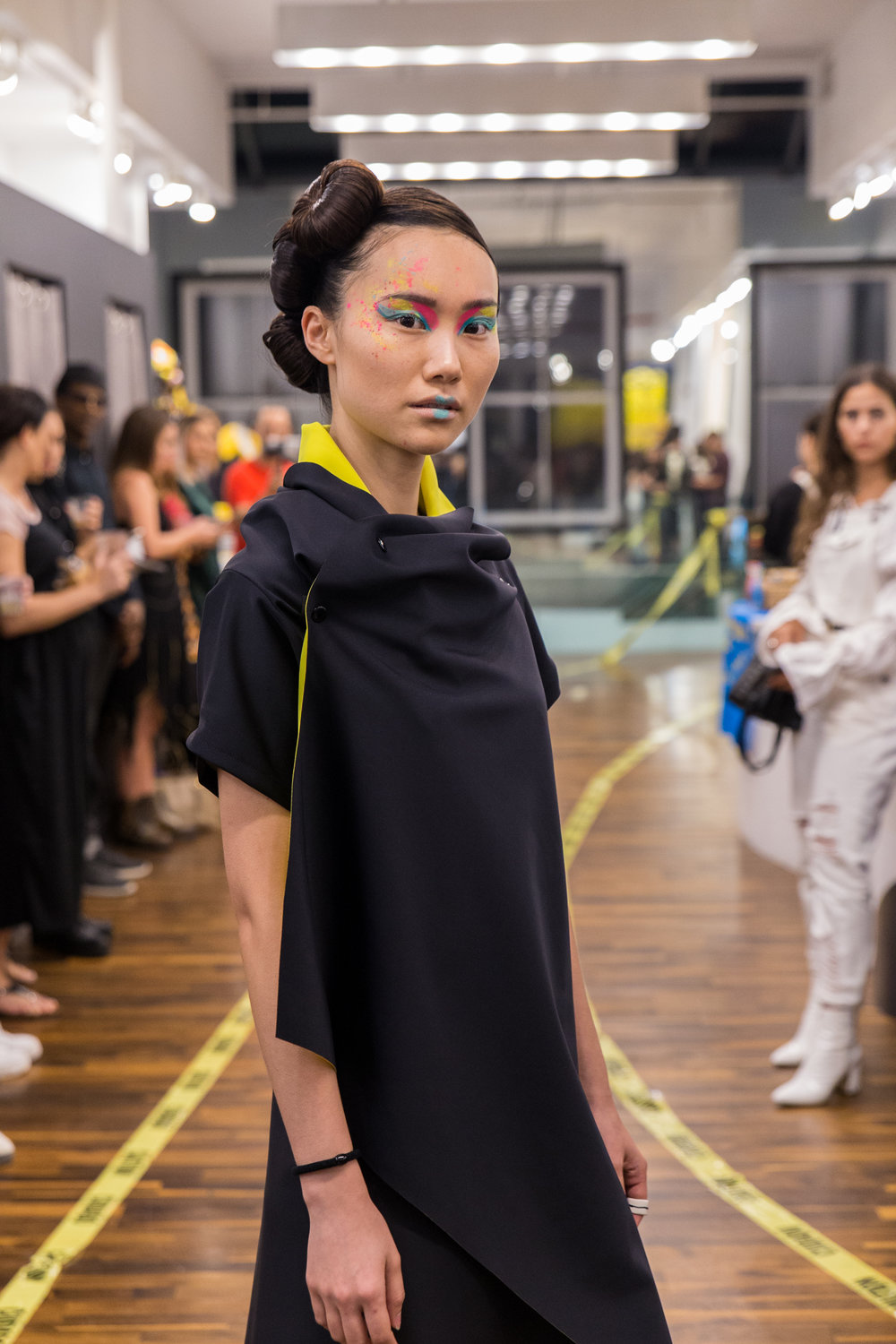 """Model at the Zero Waste Fashion Show Malaika New York wearing the """" Square Vest""""  piece from the collection."""