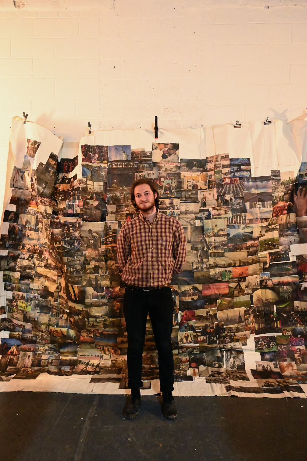 """Stephen Troiano in front of """"The Wall""""."""