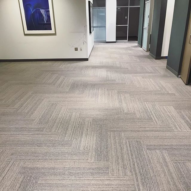 We completed this office renovation for one of our corporate clients this past weekend using @interface carpet planks in a herringbone design. We love how it turned out! What do you think?! (Local sales force @boston_interface)