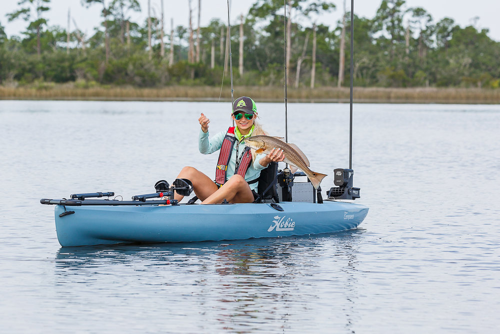 Compass_action_fish_redfish_flats_female_grip_grin_sunglasses.jpg