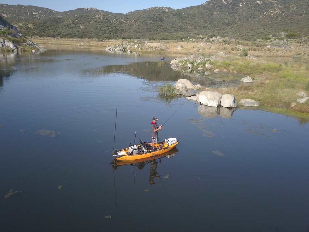 ProAngler12_action_fishing_aerial_standing_rocky.jpg