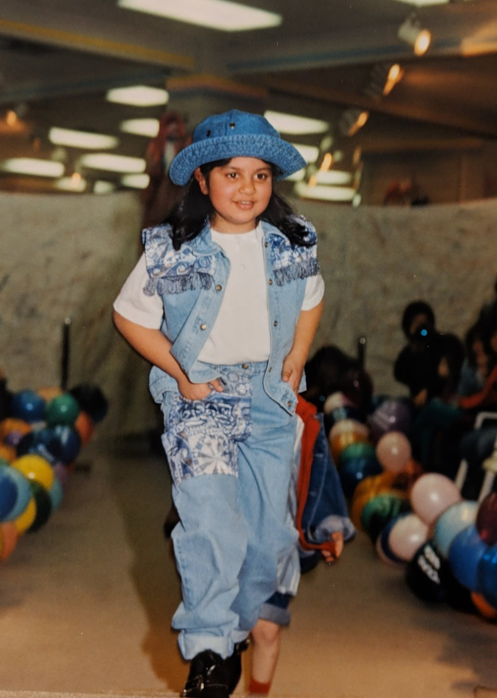 Me at about 8 years old, walking in a mall fashion show. I wanted to take home this entire outfit. I really loved denim.
