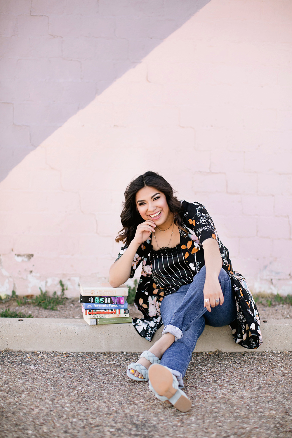 mira-senior-portrait-downtown-lubbock-fun-pink-building.jpg