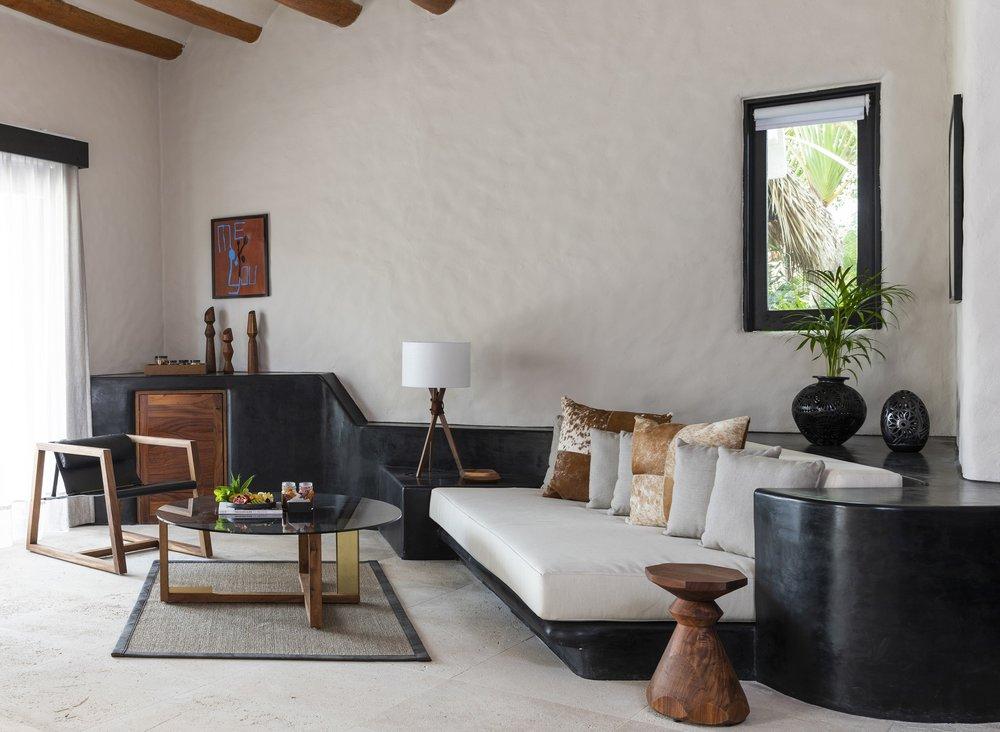 Thompson Zihuatanejo_Guest Room_Suite Seating Area.jpg