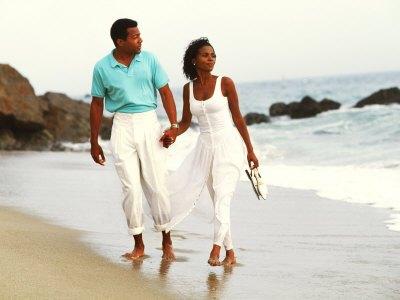 bachmann-bill-black-couple-walking-together-on-the-beach.jpg