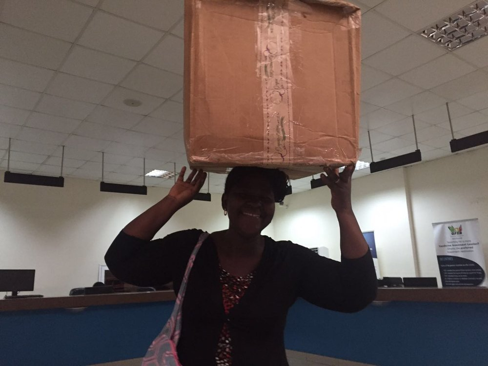 Matilda Delivers Products to Ghana Post for Shipment