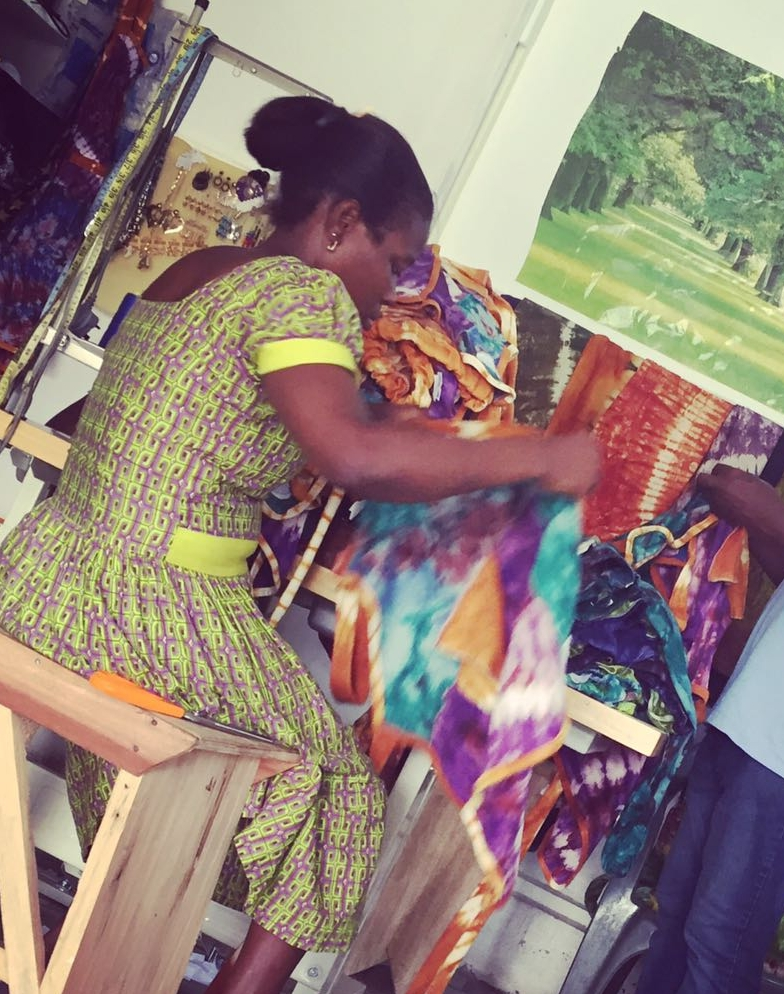 Seamstress Fixes Tags onto First Shipment of Products