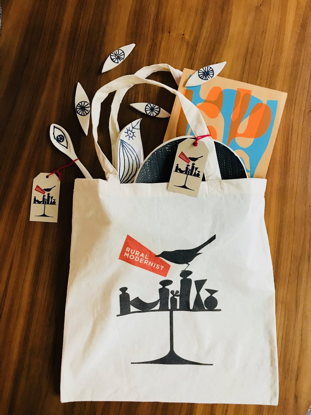 logo tote - TOTE-ally useful and charming cotton tote bag emblazoned with the Rural Modernist bird and vase silhouette illustration by Jason O'Malley.