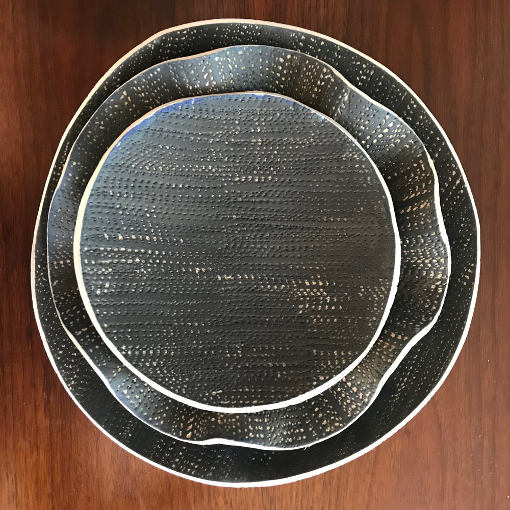 Matte Black - Glazed on top, unglazed and nude on the bottom. I textured the clay so it has the feeling of burlap fabric. Touch them and stroke them, but note that these are for decorative use only. Don't try to fill them with soup or spaghetti or you'll just make a mess.