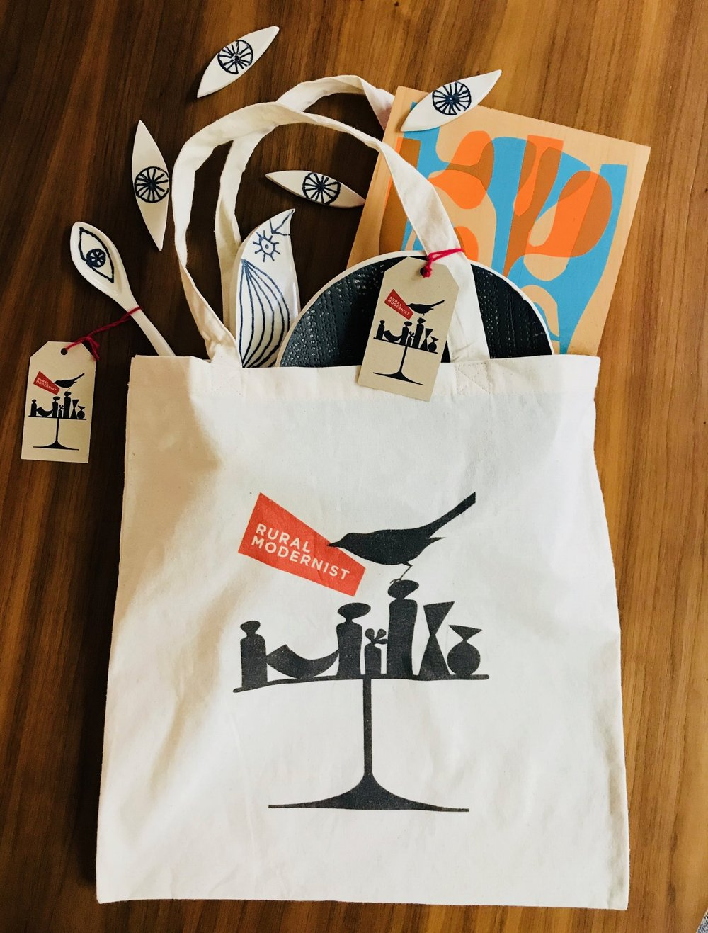 logo tote - If you don't feel like wrapping a gift, use a TOTE-ally charming cotton tote bag emblazoned with the Rural Modernist bird and vase silhouette illustration by Jason O'Malley.