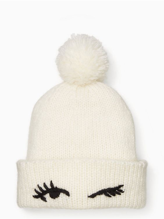 Kate Spade Winking Beanie   With the winter months fast approaching, the only thing I've been repeatedly telling my mom I want is a beanie with a fur pom-pom on top of it. This one is ADORABLE.