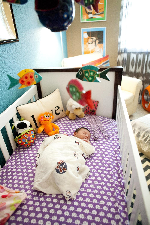 nursery-remy-in-crib-asleep-far.jpg