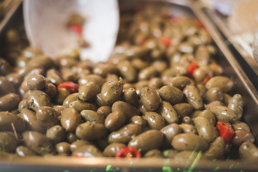 an Italian market isn't complete until you get some olives