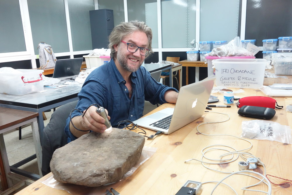 Giulio analysing a grinding stone from Ifri Oudadane (photo: Sonja Tomasso)