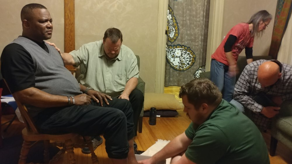 Washing Earl's feet at Thur. night meeting.jpg