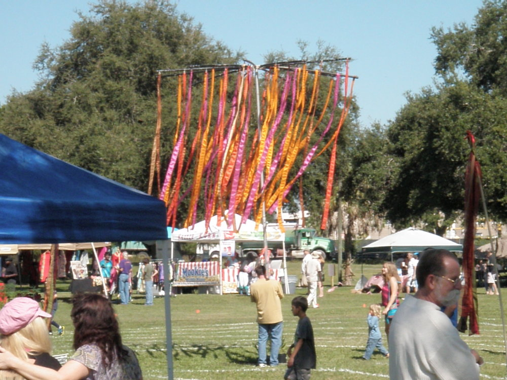 Peace ribbons blowing above the labyrinth walkers in 2015. For more images check out our photo gallery. If you have some great old ones that are hard copies,please snap some cell photos and e-mail them to us for our archives.