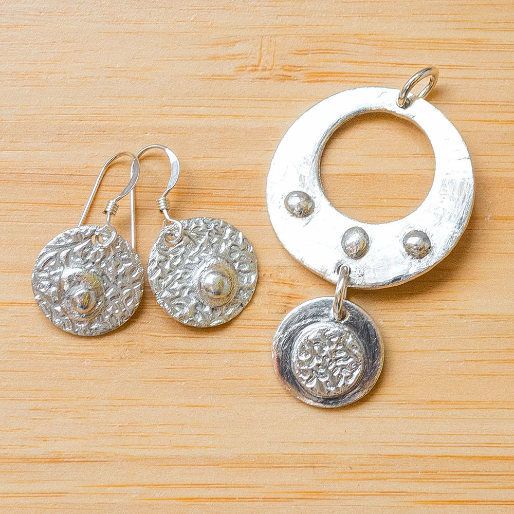 Sarah's silver pendant and earrings
