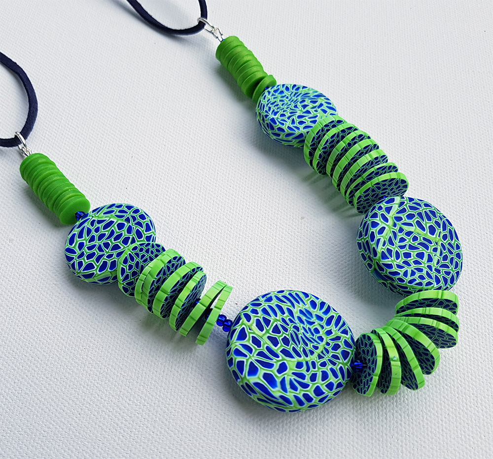 Denise's statement necklace in pearly green and blue