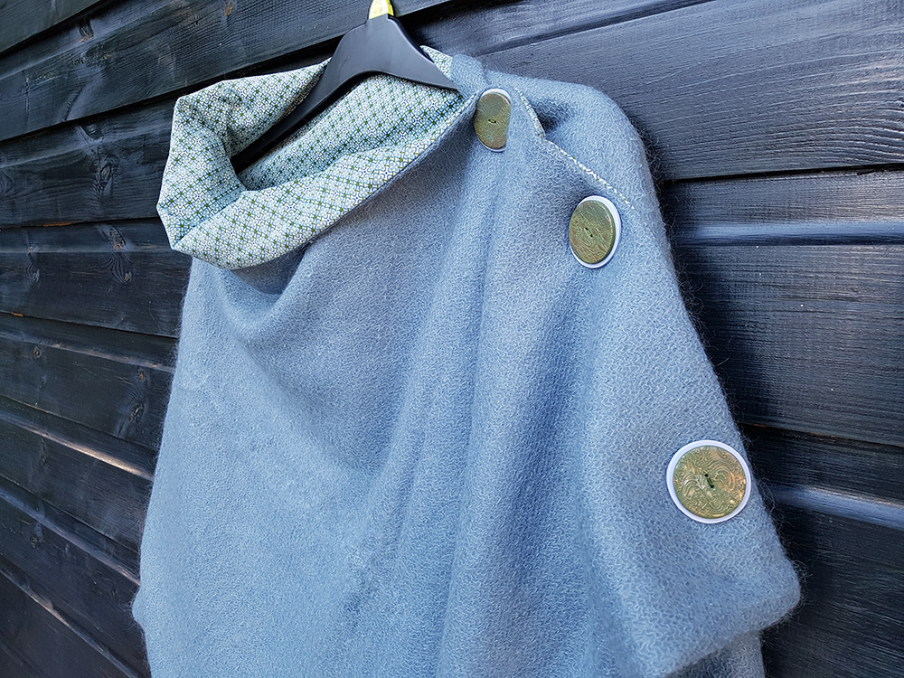 Metallic buttons on the mohair wrap